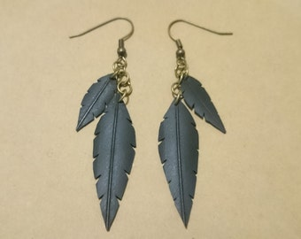 Bicycle inner tube large double feather earrings