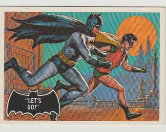 "1966 Topps Batman Trading Card (Black Bat) #28 ""Let's Go"". NM 7.  Topps Company Inc.  DC Comics."