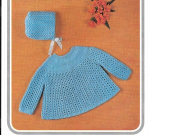 Knitting pattern for 3 or 4 ply angel top and bonnet in two sizes 18 and 19 ins.  3-6 mths and 6-9 mths