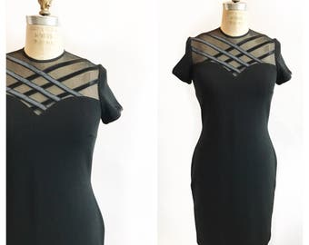 1990's stretch body con LBD with sheer illusion sweetheart neckline and ribbon detailing. Size M/L.