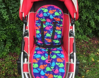 Multicoloured whale design universal stroller pram liner.