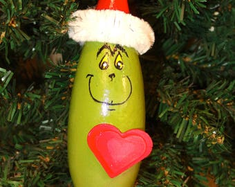 Hand painted banana gourd grinch Christmas ornament with wooden heart embellishment by Debbie Easley 13