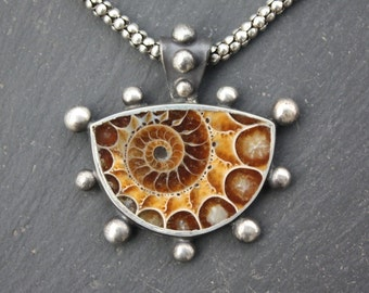 Ammonite Fossil Sterling Silver, Pendant, with torch fired bead boarder