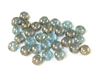 Light Blue transparent w/ Antique Gold flecks smaller 3 x 5mm rondelles. Set of 30 or 60.