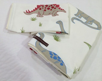 Ivory Dinosaurs Print by Laura Ashley Cot/Cotbed duvet cover and pillowcase set.