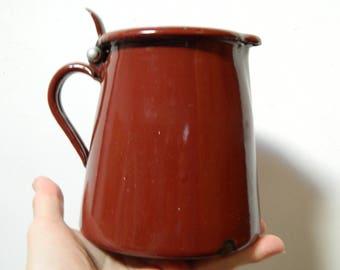 Vintage enamel milk jug
