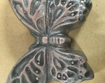 copper concrete butterfly