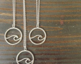 Wave pendant necklace;  sterling silver