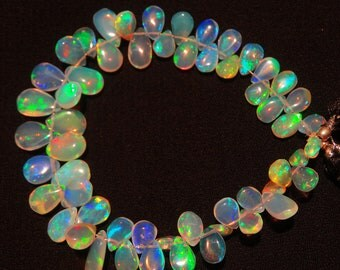 Natural Ethiopian Welo Opal Rare Pear Shape Briolettes 4x6 to 7x10MM 6 Inch Full Strand Ultimate Quality Super Rainbow Electric Fire Play