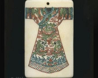 Polychrome scrimshaw ox-bone pendant with dragon robe design 48x30mm. Sold individually. B3-bo171(e)