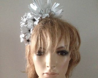 white leather handcrafted flowers,centred with black swarovski crystals,mounted on a headband