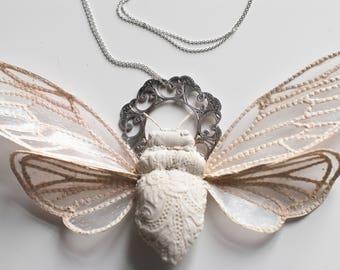white-creme cicada pendant,fiberart, soft sculpture,