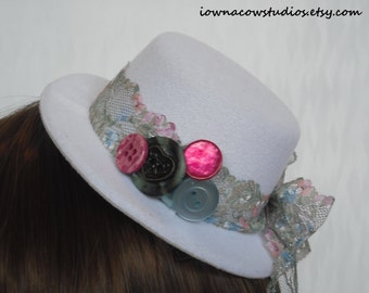 white mini top hat fascinator with lace bow and vintage buttons