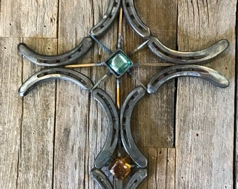 Handmade metal horseshoe cross made from reclaimed horse shoes