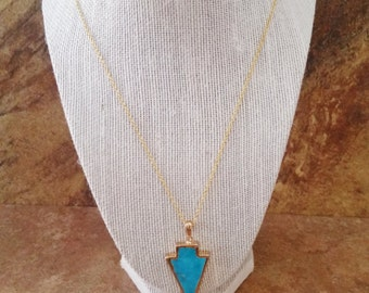 Arrowhead Agate Pendant Necklace. 1 1/2 inch Natural Stone Pendant. Sky Blue Colored Stone. Gold Edge on Small Gold Chain. Classy and Unique