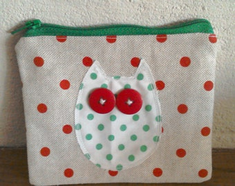 Beige and red spotted purse with owl detail.