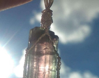 Bi color purple and green tourmaline wire wrapped pendant 27 carats