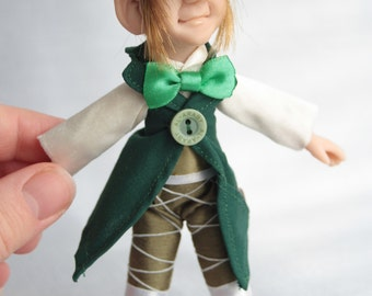Cotton and polymer leprechaun doll with green jacket and coin - elf gnome gobelin
