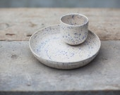 Set of two raku pieces: handmade cup + dish / opaque white speckled blue glaze