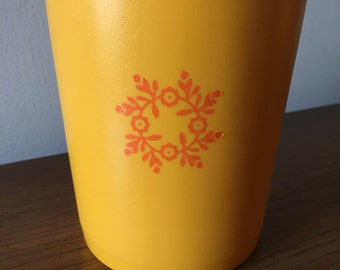 Yellow Tupperware Canister