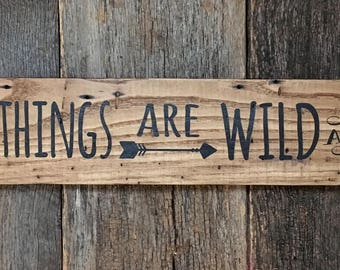 All good things are wild and free with arrow Henry Thoureu Quote: Hand-Painted on Reclaimed Wood Barnwood Lumber Sign