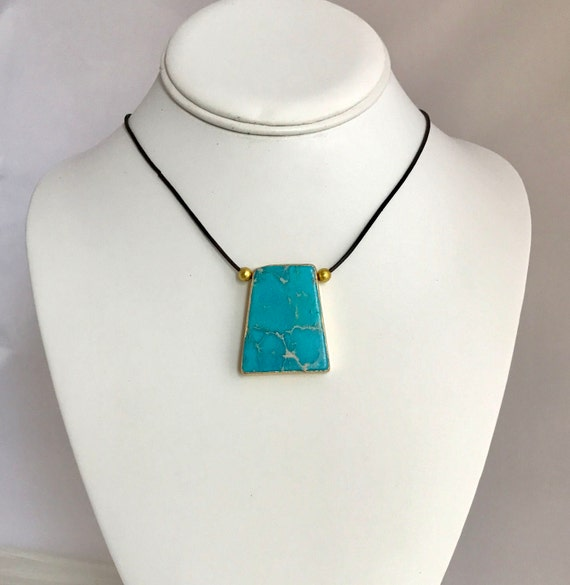 statement necklace, blue dalmatian jasper pendant, leather cord, gold edging