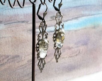 Steampunk Earrings made of silver colour  filigree with resin cabs and watch gears  for pierced or unpierced ears