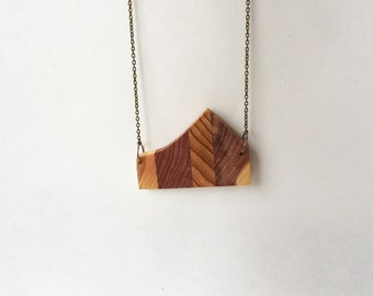 Cedar and cypress pendant necklace made from reclaimed wood