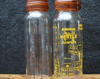 Old feeding bottle with rubber teat, vintage baby bottle with rubber teat, nursing bottle with rubber teat, Nestlé.