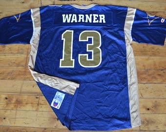9983fe1e23e ... Vintage 90s Champion St. Louis Rams Kurt Warner Jersey (Size 44) ...