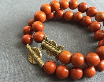 emem - wood and brass beaded bracelet