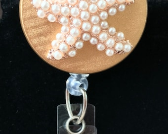 Pearl Starfish with Gold Badge Reel