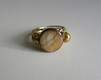 Mother-of-Pearl coin focal with gold pearl accents.