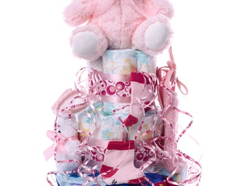 DODOT diaper cake. An original gift for the newborn baby, including plush, sock, bib, DODOT towels and towel facial.