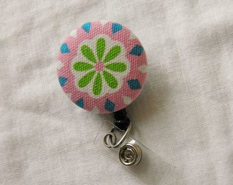 Flower badge reel, ID holder, retractable badge