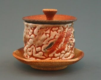 Lidded Cup and Saucer, woodfired stoneware w/ crawling shino and natural ash glazes
