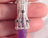 Woven wire wrapped polished Amethyst crystal with Hematite, pendant