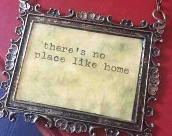 Theres no place like home words quote saying story book necklace wish love typewriter wizard of oz dorothy