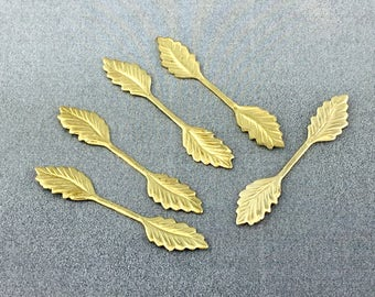 Five brass leaf stampings