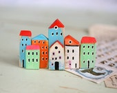 a colorful wooden town for wall decoration. Little wooden houses for the wall. Rustic wooden houses for the wall. Wall decoration.