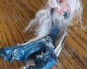 Cute mermaid in an oyster shell
