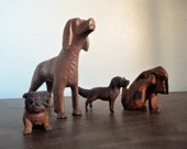 Reserved for Peter uhosman Collection of Four Antique Carved Wood Dog Figurines