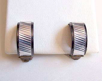 Germany Black Half Hoop Clip On Earrings Silver Tone Vintage 1960s Slant Deep Etched Lined Curved Band Enamel Edge Open Discs