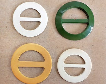 Four Celluloid Scarf or Belt Buckles