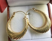 14K yellow gold loop 3 gram earrings.   VJSE