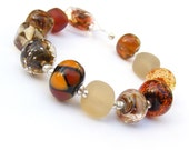 Lampwork orphans - glass bead set of 12 mainly brown and taupe renegade beads