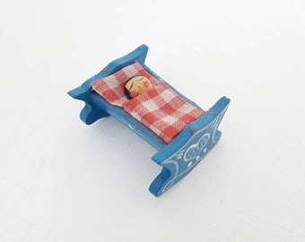 Vintage Tiny Handpainted Wooden Folk Figurine Erzgebirge Sleeping Baby in a Blue Rocking Bed with a Red and White Gingham Blanket