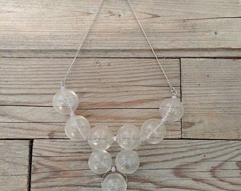 bubble transparent handblown glass necklace with dusty light blue and red elastic string