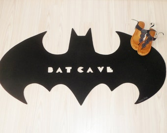 Bat Cave. Rug based in a Batman logo. Shape doormat. Custom door mat logo.