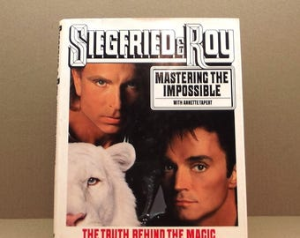 Siegfried and Roy and the white tigers, signed first edition, complete with 2 programs to the Las Vegas show at the Mirage and tickets